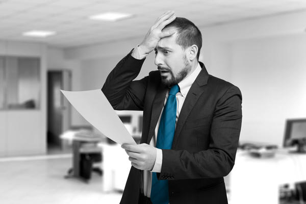 business-man-facepalming-looking-at-document