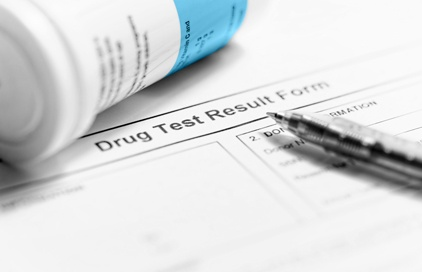 drug-test-form-with-pen-and-bottle